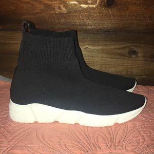 Black material sneakers